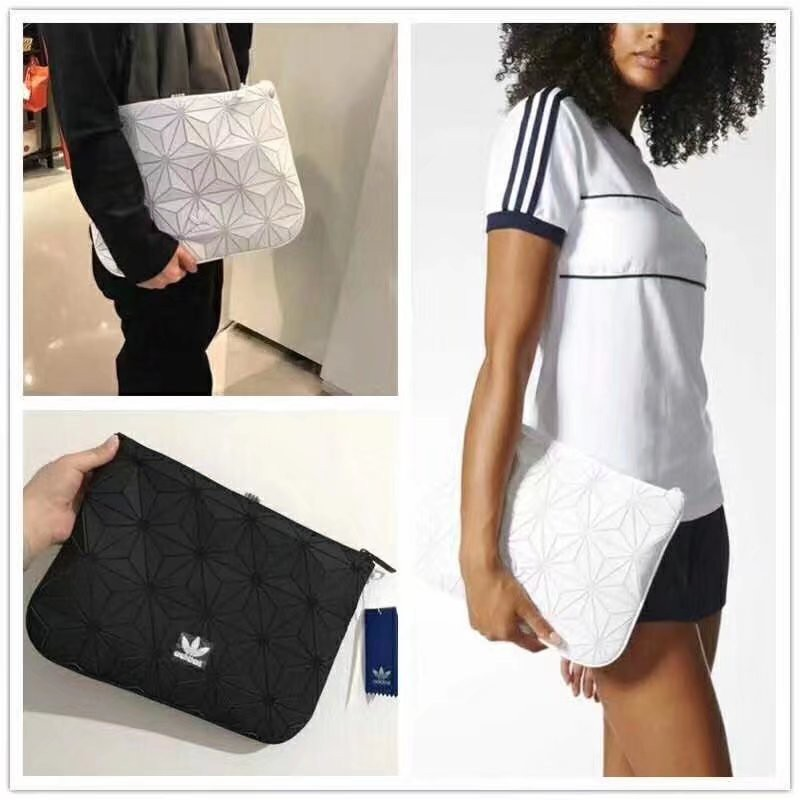 9cf47f295ddc 🔥In Stock🔥 Issey Miyake 3D Clutch Sleeve Adidas Hand bag Men s and  women s bag