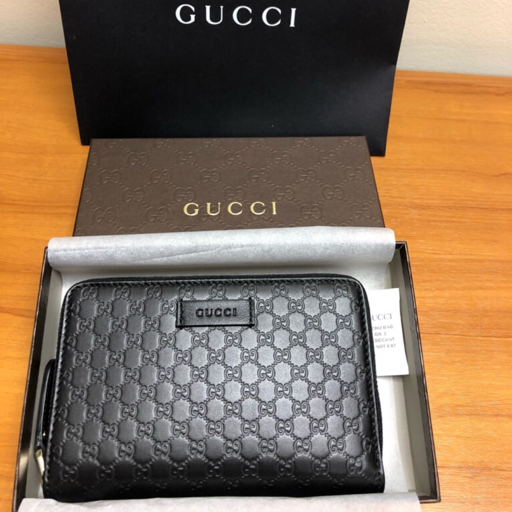 ac05dcbe7208 [ASK FOR PRICE]GUCCI Print leather bi-fold wallet | Shopee Singapore