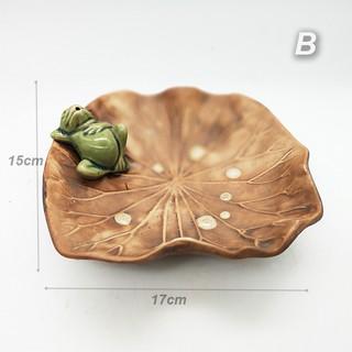 porcelain frog sleeping on lotus leaf plate suitable for