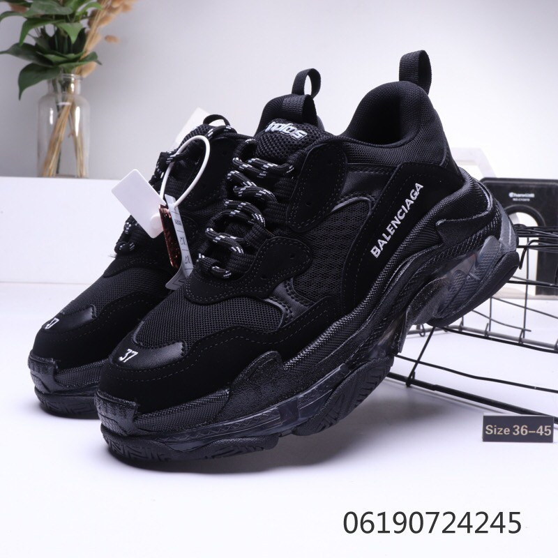 The Balenciaga Triple S black 2018 that bears the influencer