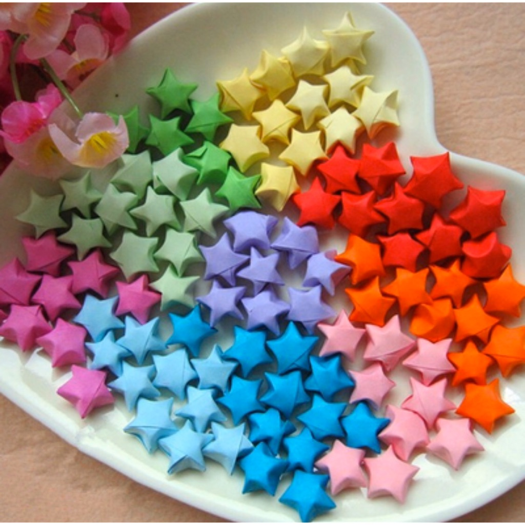 Colorful Origami Lucky Stars Background. Close Up. Stock Photo ... | 1024x1024